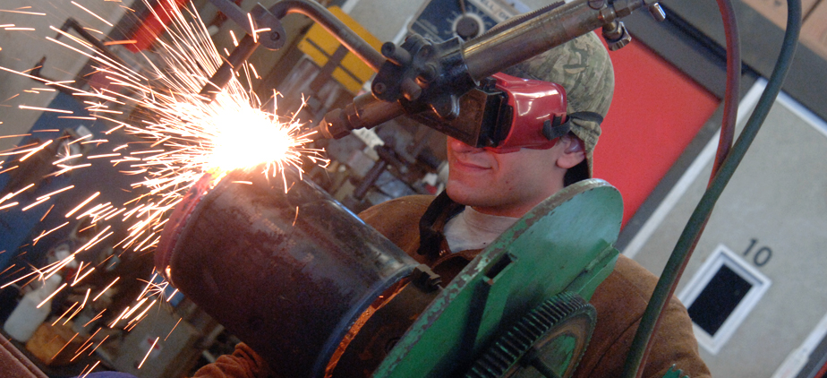 Student working in a welding workshop